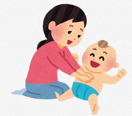 赤ちゃんのお腹をマッサージしているイラスト